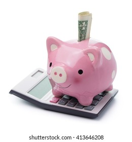 Pink color piggy bank with US money and calculator