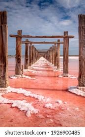 Pink color of salt lake and deep blue sky,  minimalistic natural landscape, Ukraine travel background. Miracle of nature