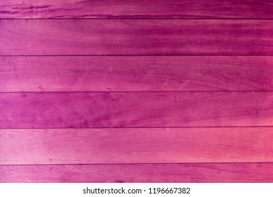 Pink color wooden board paneling. Wood texture, top view