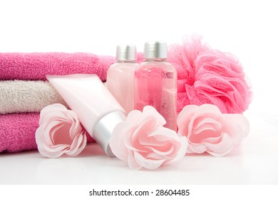 pink colored bath accessory, isolated on white background