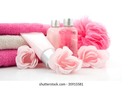 pink colored bathroom and spa accessory over white background