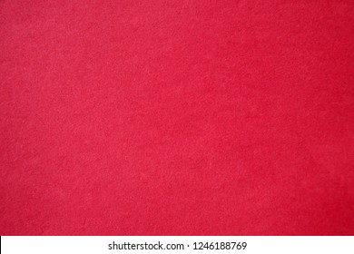 Pink Colored Construction Paper. Close up view of Colored Construction Paper. Backgrounds and Textures. Opacity filter used to lighten and grade the image.