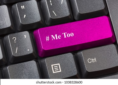 Pink colored Me Too button on black computer keyboard. Sexual harassment concept.
