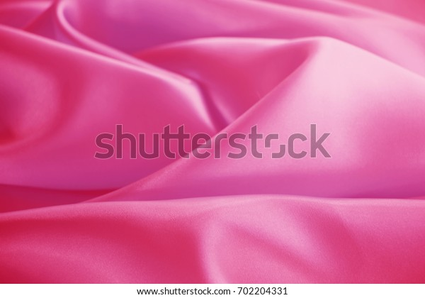 pink colored silk texture luxurious satin for abstract background,design and wallpaper,soft and blur style,smooth.