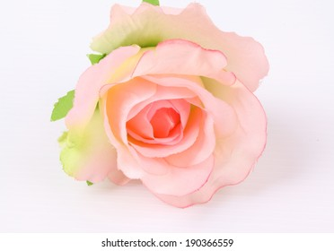 Pink colorful textile rose closeup