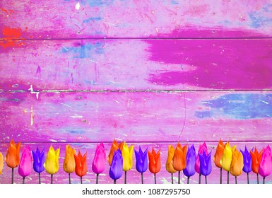 Pink colorful tulips background with shabby distressed grungy texture hippie style