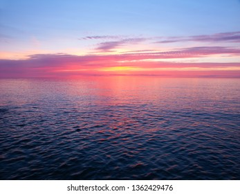 Pink colors reflect off Lake Superior in northern Michigan
