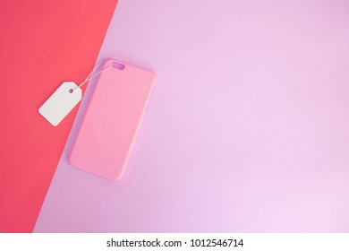 Pink concept : Top view of mock up clear phone case pink color with price tag on color pink background, copy space, branding, corporate