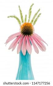 Pink cone flower with grass seed pods in pastel blue bud vase