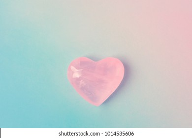 Pink Crystal Quartz Heart on Gradient Pastel Color Blue Magenta Background. Romantic Valentines Mother's Day Charity Concept. Greeting Card Poster Template. Website Banner. Copy Space