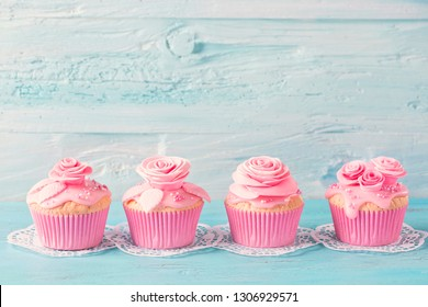 Pink  cup cakes on a blue background
