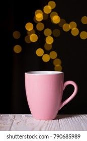 pink cup of coffee and bokeh in the background
