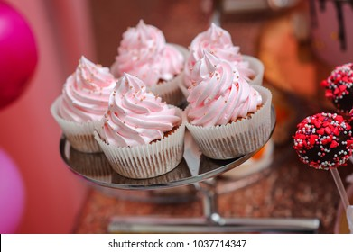 Pink cupcakes on the plate on the candy table