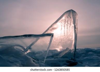 pink dawn in winter, ice block of ice in the sea
