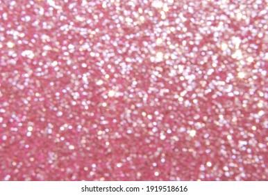 Pink de focused sparkle glitter background close up, bokeh texture