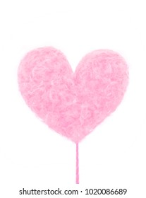 Pink delicious heart made of sweet cotton candy isolated on white background. Trendy minimal art style.