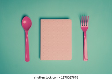 pink diary for keeping notes of food and health plans