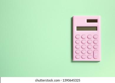 Pink digital calculator on green background