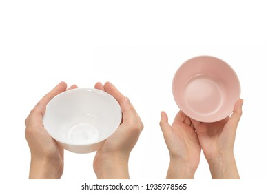 Pink dish in woman hands isolated on white background.