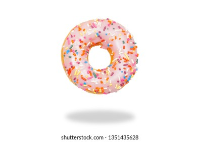 Pink donut with icing on white background.