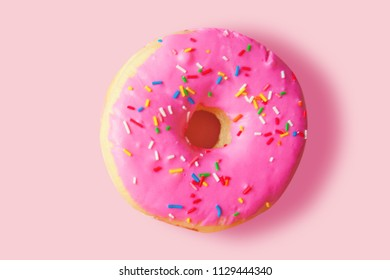 Pink donut on a pink background