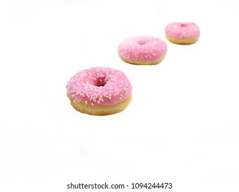 Pink donuts isolated. Freshly baked donuts on a white background
