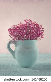 Pink dried babys breath flowers blue stock photo royalty free pink dried babys breath flowers in a blue jug on wooden background and vintage wallpaper mightylinksfo