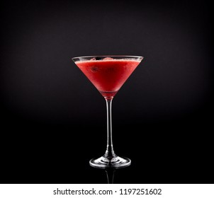 Pink Drink in Martini Glass, Slush Ice summer drink, isolated on black background
