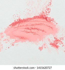 Pink eye shadow or bronzer  smudge on white background.