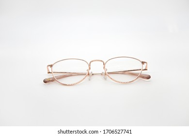 Pink eyeglasses with white background