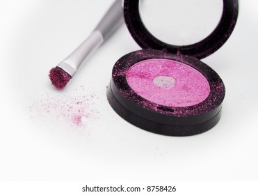 Pink eyeshadow with applicator brush