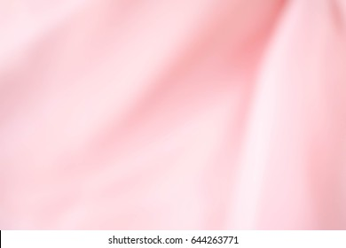 pink fabric textures background ,fabric uneven. abstract blur of pink fabric for Valentine's background. pink silk fabric defocused for background