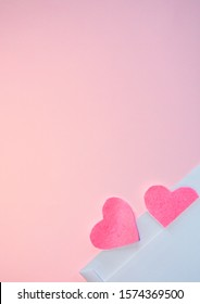 Pink felt hearts and letter on a pink background. Happy Valentine. Flat lay.
