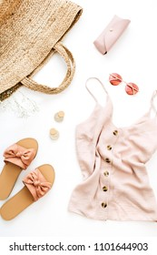 Pink female clothes and accessories on white background. Flat lay, top view. Summer fashion concept.