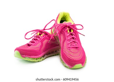 Pink female jogging shoes isolated