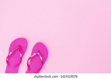 Pink flip flops shoes with sequins on pink background, top view, with copy space. Toe sandals in polka dot, flat lay, text place. Summer background with flipflop shoes, flatlay