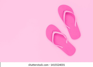 Pink flipflops shoes on pink background, top view, copy space. Toe sandals, flat lay, text place. Summer background with flip flop shoes