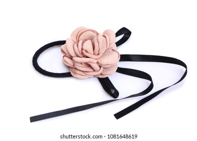 Pink flower hair band handmade isolated on white background