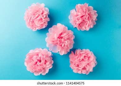 Pink flower pattern on blue pastel background. Minimal spring concept. Flat lay. Top view