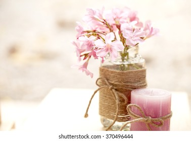 Pink flower in soft focus on soft light background.