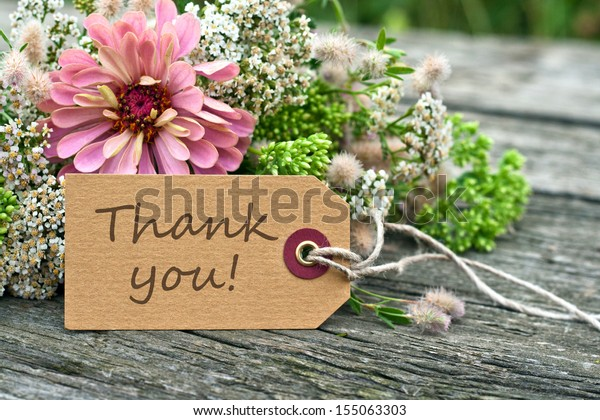 pink flowers and card with lettering thank you/thank you/english