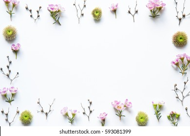 Pink flowers frame on white background.