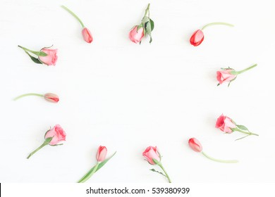 Pink flowers. Frame with rose flowers and tulip. Easter, spring concept. Flat lay, top view
