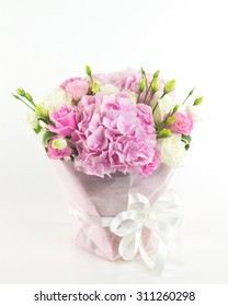 Pink flowers in vase isolated.