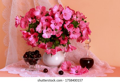 Pink flowers vase on table. Vase of pink flowers. Pink flowers still life. Pink flowers in vase