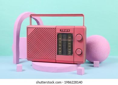 Pink fm radio on podium with geometric shapas. Concept art. Fashion Minimalism