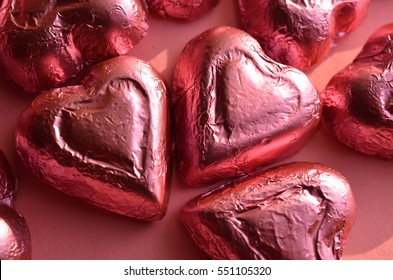 pink foil wrapped chocolate heart shape candy Valentine's Day