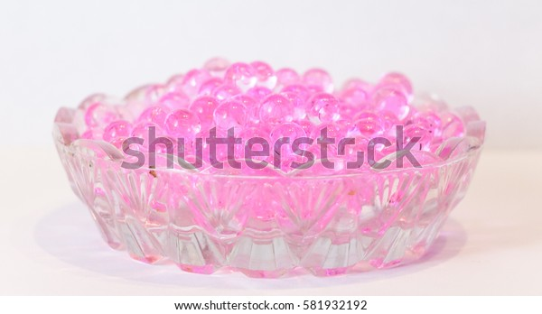 Pink fragrant droplets with a pungent smell in the saucer for jam