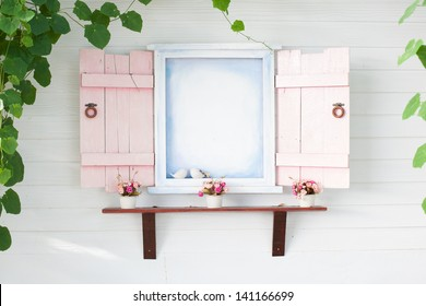 pink frame window with green leaves