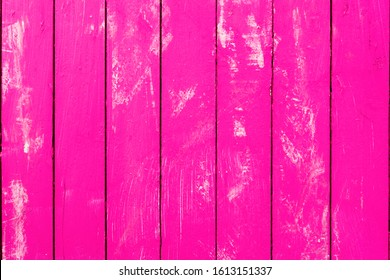 Pink fuchsia wood background  made of vertical planks - Magenta color wooden texture board with white paint scratches - Image